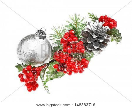Glass ball, mistletoe, strobile and pine-tree branch isolated on white