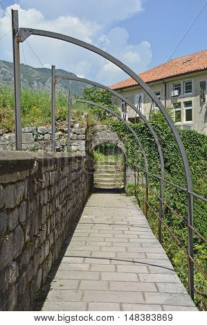 An historic walkway in Kotor old town which forms part of the town's defensive walls.