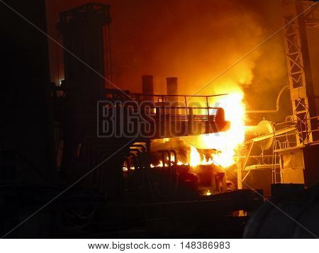 Heat and frame from iron melting from Iron and steel factory.