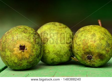 Pears on wooden background. Green pear close-up