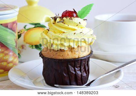 Cupcake with yellow cream. Celebratory cupcake close-up
