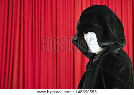 Magician with magic mask on stage,  color image