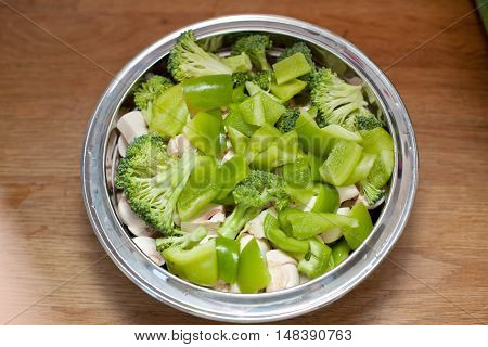 Mixed Green Vegetables In A Metal Bowl