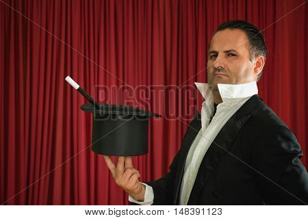 Magician Holding Top Hat And Magic Wand