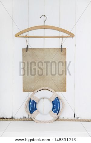Maritime background with a blue and white safety buoy on old wooden vintage background for sailing, emotions, feelings or adventure concepts.