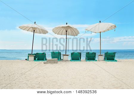 Beautiful tropical beach in front of a turquoise sea and with a blue sky. Stock image.
