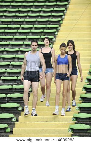 group of young sport athletics people walking together