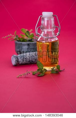 Tulsi oil or holy basil oil with Mortar and Pestle, tulsi or holy basil is a qeen of herb since ancient times in India in Ayurveda