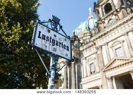 Berlin Germany August 27 2016: Sign of Lustgarten on the background of Berliner Dome summer time