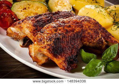 Roast chicken leg and vegetables