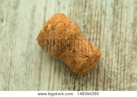 Cork from a champagne bottle on a wooden background worn