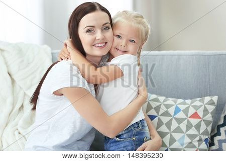 Mother and daughter on couch
