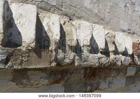 White brick wall with cracked plaster casts shadow background
