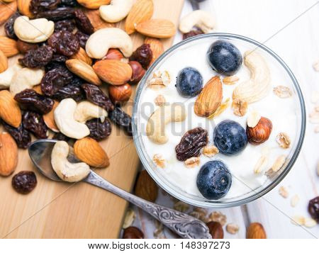 Healthy dessert with yogurt nuts oats and blueberries