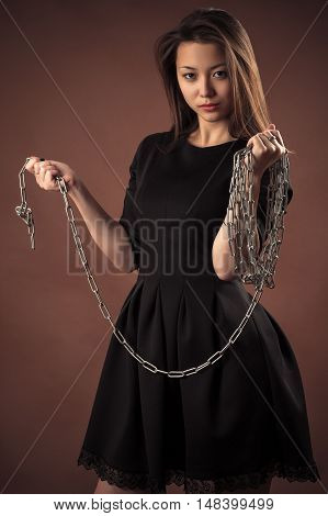 brutal korean girl with chain in hands