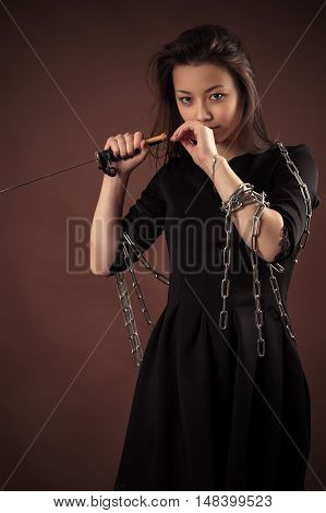 brutal korean girl with sword on brown