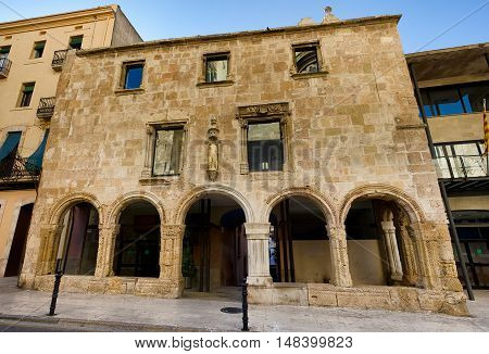 Facade of the roman building preserved till our time in Tarragona, summer Spain