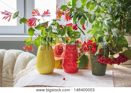 Autumn table with bunch of autumn plants in bright planters