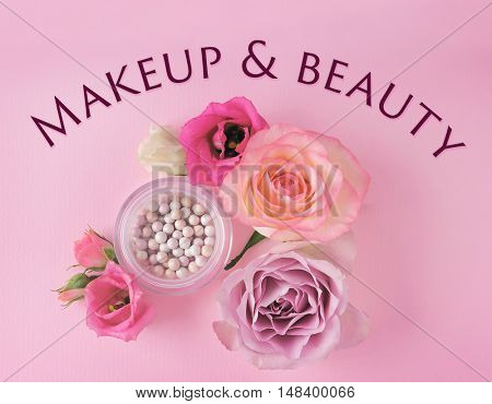Blusher and flowers on pink  background