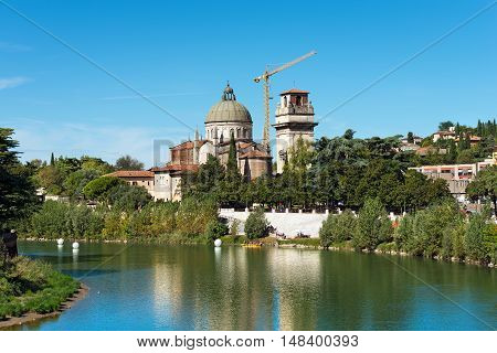 The church of San Giorgio in Braida (XVI century) and bell tower (XII century) by Adige River in Verona (UNESCO world heritage site) Veneto Italy