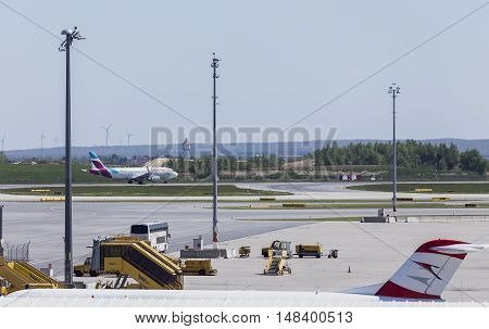 VIENNA, AUSTRIA - APRIL 30th 2016: Plane leaving for taking off on a busy Saturday at Vienna International Airport.