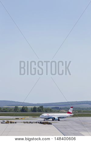 VIENNA, AUSTRIA - APRIL 30th 2016: Plane moving to take off area at Vienna International Airport on a busy Saturday.