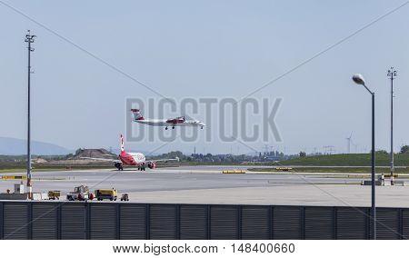 VIENNA, AUSTRIA - APRIL 30th 2016: Plane Landing at Vienna International Airport on a busy Saturday.