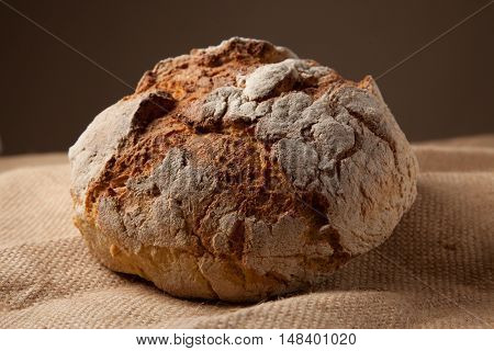 Close Up View Of A Portuguese Traditional Baked Bread On Brown Background.