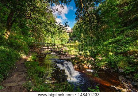 Ash Gill Riverside Walk,as it flows over Ashgill Waterfall, just before it enters the River South Tyne near its source on Alston Moor in the North Pennines