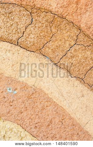Layer of dry soil cracks texture and background