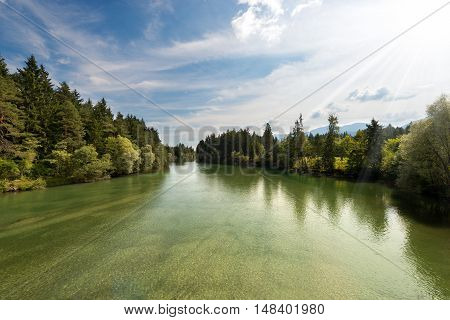 The green Gail River the largest tributary of the Drava River. Carinthia Austria