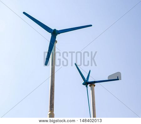 wind turbines and natural blue sky with sunlight