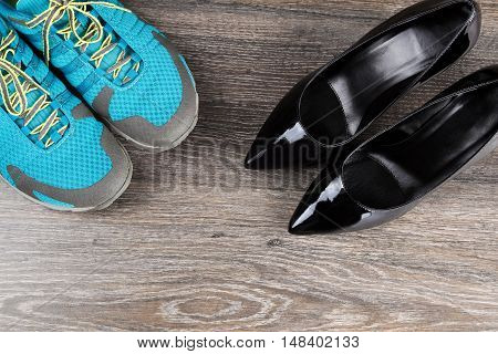 Pair of sneakers with classic black heeled shoes