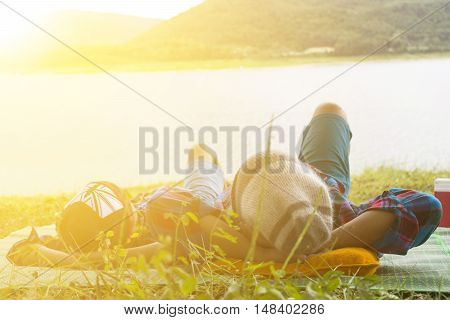 Father and son are happy for picnic with nature background and sunrise view.Zoom in
