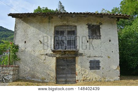 An old historic farm building in the small Italian village of Vernasso in Friuli Venezia Giulia north east Italy.