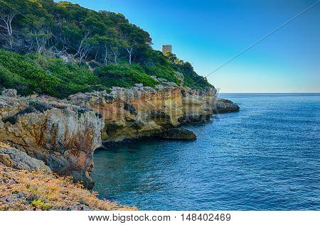 Azure sea and rocky coast near Mora Tarragona, summer Spain
