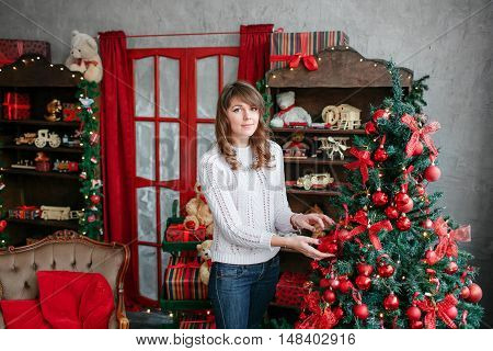 Christmas atmosphere, children's room decor for the holiday. Portrait of happy girl looking at camera