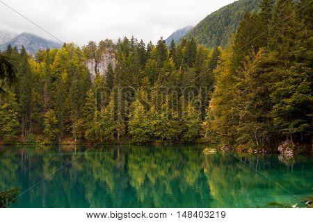 Lago di Fusine (Fusine Lake). Small mountain lake with forest and the reflections. Julian Alps Tarvisio Friuli Venezia Giulia Italy