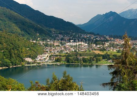 Aerial view of the small town of Levico Terme with the lake and the mountains. Trentino Alto Adige Italy Europe