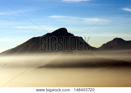 The peak of Monte Pizzocolo 1581 m. (Pizzocolo Mountain) with the fog of the Garda Lake. Lombardy Italy Europe