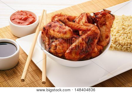 Chicken wings roasted with ginger and tomato sauce.