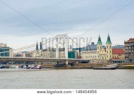 Elisabeth Bridge or Erzsebet hid the Inner-City Parish Church and River Danube in Budapest, Hungary.