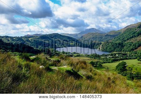 View of Snowdonia national park with lake in the foreground