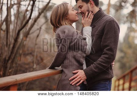 loving young couple happy together outdoor on cozy warm walk in autumn forest
