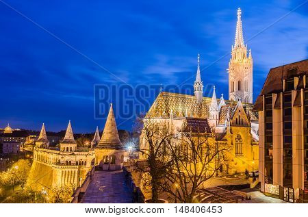 Night view of the Matthias Church is a Roman Catholic church located in Budapest, Hungary in front of the Fisherman's Bastion at the heart of Buda's Castle District.