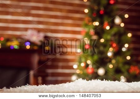 Composite image of room decorated at Christmas time with Christmas tree