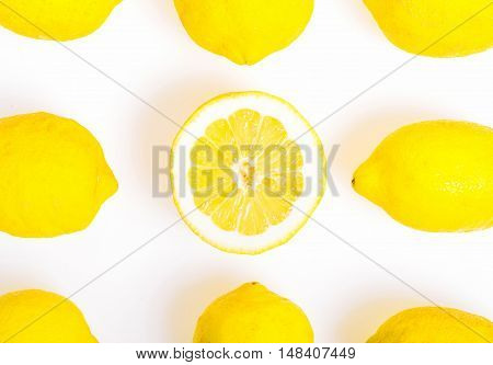 Composition with nine Lemons one of them cut in half photo Flat Lay Style and Square cut