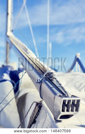 Rope chekel on the boom fix a mainsail and attached Main-sheet