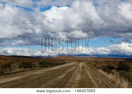 Brown Road  And Cloudy Sky In Prince Albert