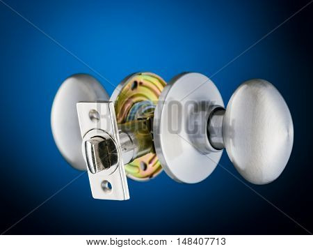 Complete door knob mechanism isolated on blue and black background